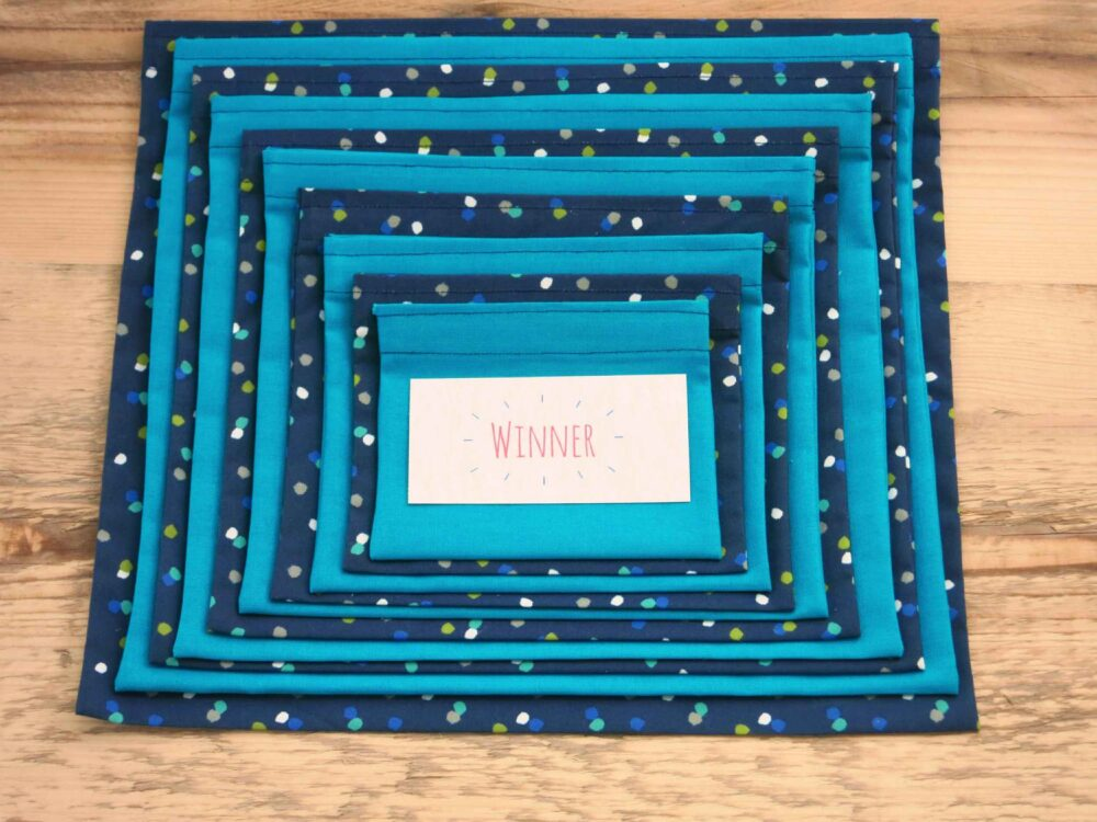 Ready made Pass the Parcel with alternating layers of Blue Spotty and Teal fabrics