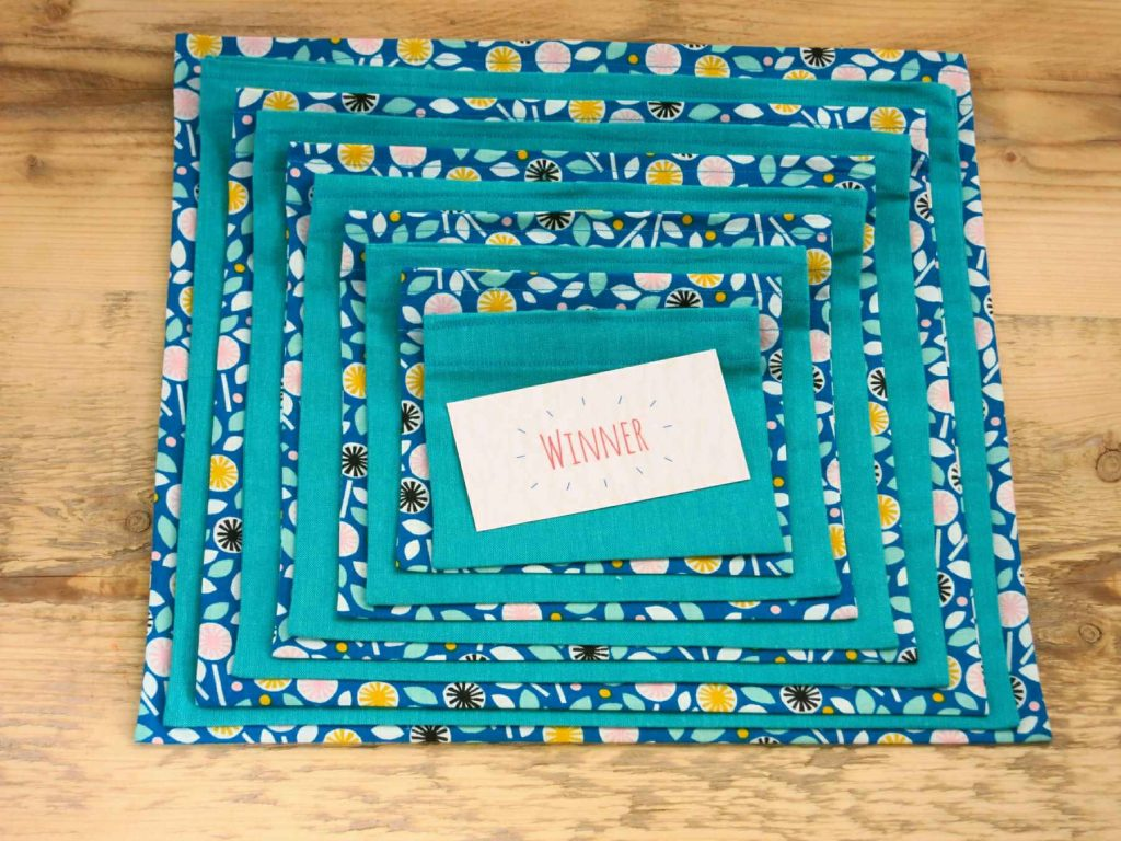 An eco pass the parcel set in Blue Floral fabric