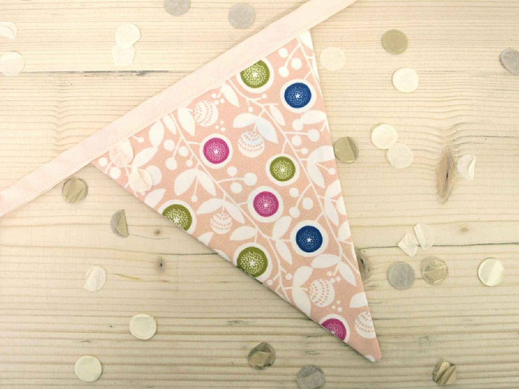 A single flag of pale-peach floral bunting