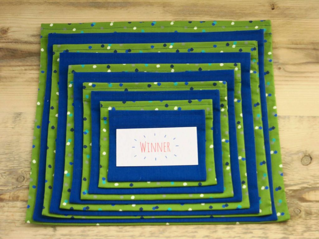 Pass the Parcel with a difference - alternating layers of Green Spotty and Blue fabrics