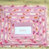 Pink Butterfly reusable Pass the Parcel game with alternating layers of Pink Butterfly and plain Dusky Pink fabrics