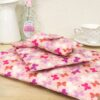 A pile of reusable fabric gift wrap pouches in Pink Butterfly fabric; fabric wrap that can be torn open & reused
