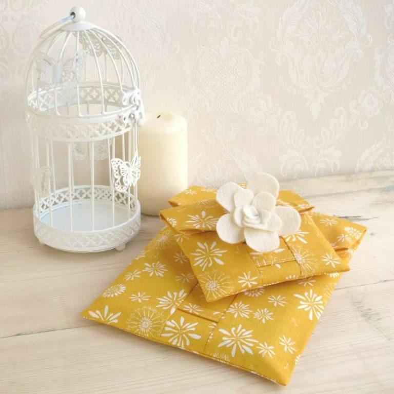 A set of Gold reusable gift wrap pouches