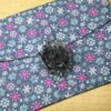 Large grey fabric flower on a large gift wrap