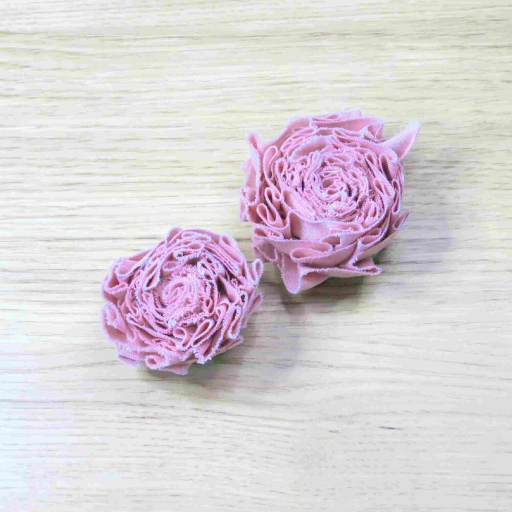 Two pink fabric flowers - one Small and one Large