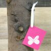 Pink Butterfly Gift Tag hanging from a branch