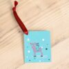 A reindeer gift tag with a red ribbon