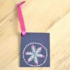 Silver Snowflake gift tag with a pink ribbon